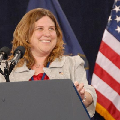 Shelby Wright Smiling at Lectern